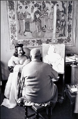 model posing for a drawing by Matisse; Oriental wall hanging in background