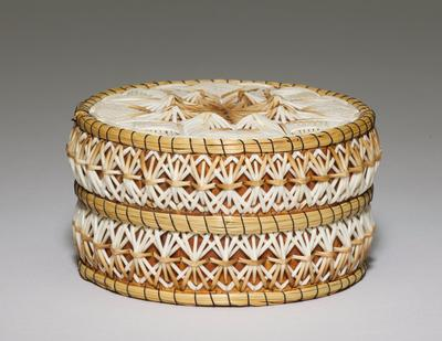 drum shaped box; birch bark base; top of cover decorated with star motif with white and light brown porcupine quills; one band around edge of cover and one band around box with repeating X-motifs