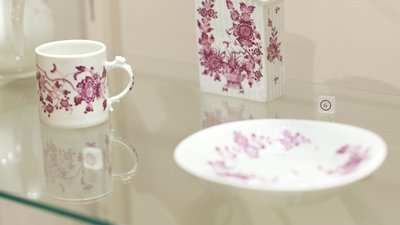 Cup and Saucer with floral decoration in carmine.
