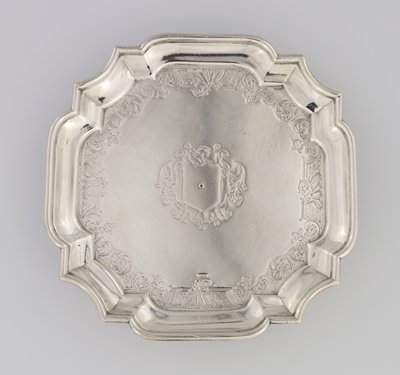 salver, square, on four legs; moulded rim and indented corners; center engraved with mantled shield surmounted by plumed helmet; within rim a band of engraved shellas and rosettes