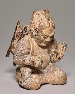 one of pair of Onis (Buddhist demons); wood and polychromed; seated, holds scroll and carries pack on back