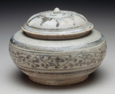 Sawankalok ware; cover with pointed finial; floral patterns and bands circling body underglazed in blue, grey and brown on pale grey crackeled ground.