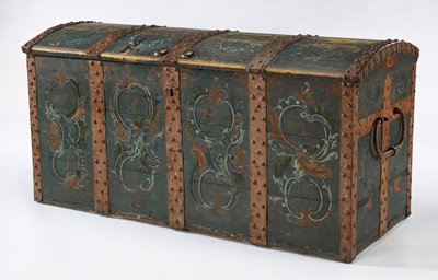 Chest with five painted and studded iron bands; painted blue with organic designs between bands; large c-shaped handles; key has circular top element with teardrop shape with small hole extending from shaft; key in key cabinet MS