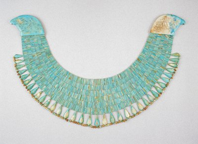 broad collar of blue faience beads, an extraordinarily large example of funerary jewelry typical of the middle kingdom; blue glazed faience.