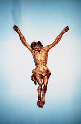 image of a gold crucified christ figure with no cross on a white and blue ground; not signed