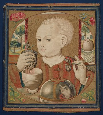 bust portrait of Christ as a child with light wavy hair, with a high hairline, with head turned slightly toward PR; Christ squeezes a bunch of grapes in his PR hand, with the juice running into a white footed bowl; Christ holds a small bunch of grapes in his PL hand, which are reflected in the silver cross-topped domed cover in foreground; small portions of view of a landscapes in top corners; portrait in a tondo, with flowers in each corner