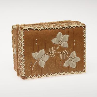rectangular box with cover; medium brown; white quillwork with spray of flowers on cover and individual blossom on each side of box; X motif trim