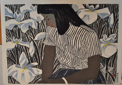 girl in striped blouse with white and blue irises