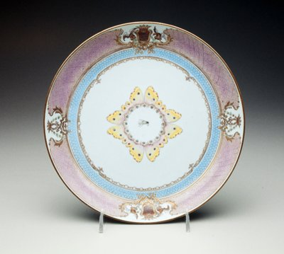 armorial porcelain deep dish painted with fly amidst butterfly wings, turquoise ground with reserve cartouches enclosing arms and monogram of Grimaldi