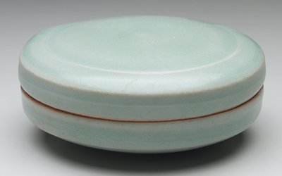 flat circular ceramic seal paste box with celadon glaze; unadorned, tapered lower half to a 1-3/8 inch concave unglazed base