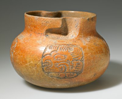 reddish ceramic jar with incised decoration on four sides; groove design feature, around lip indicates the jar has a screw on cover