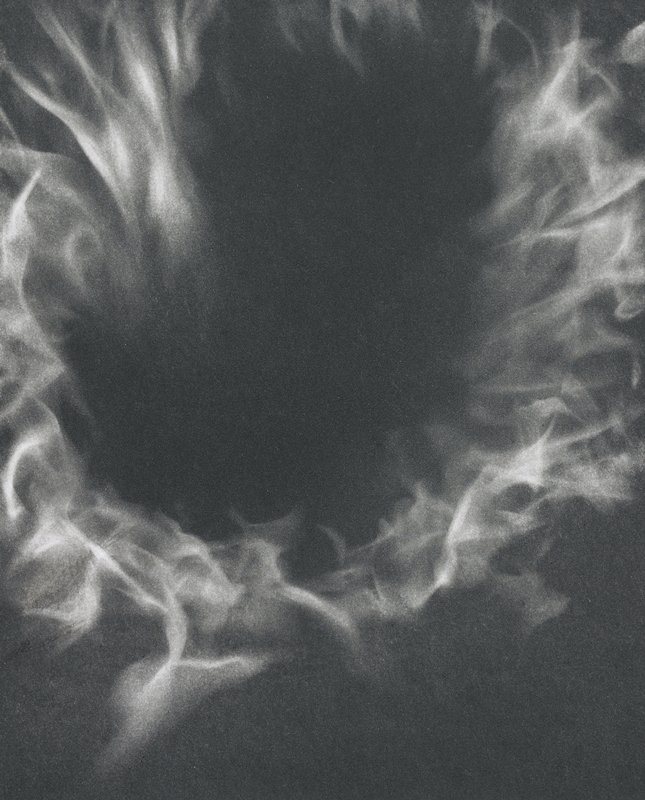 abstracted image; ring of flames on a dark ground