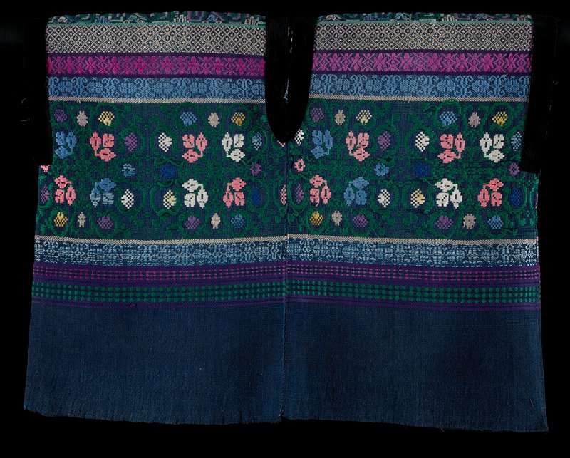 dark blue; top section woven in purple, pinks, blues, white and yellow--bands of dots, dots and lines, and floral patterns; black velvet trim