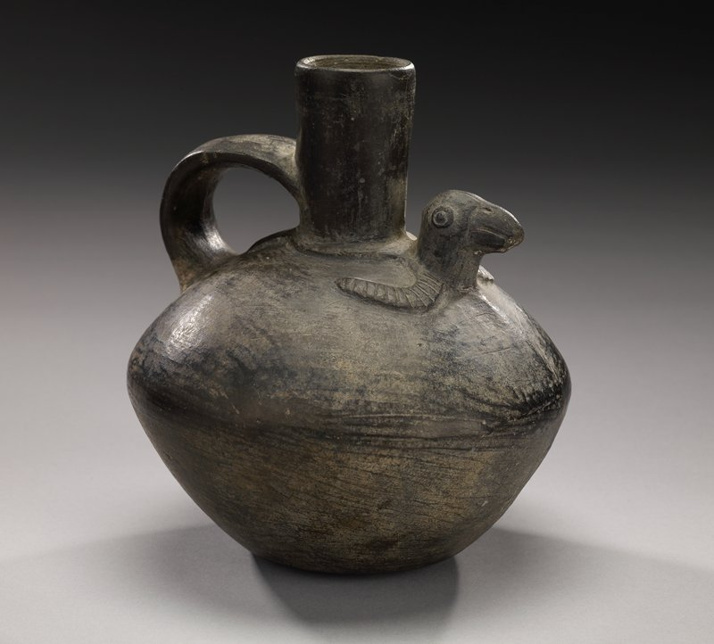 pointed shoulder; slightly rounded base; straight top spout; wide, flat handle from spout to shoulder; 3-D bird's head in front of spout; stylized bird wings and tail- flat