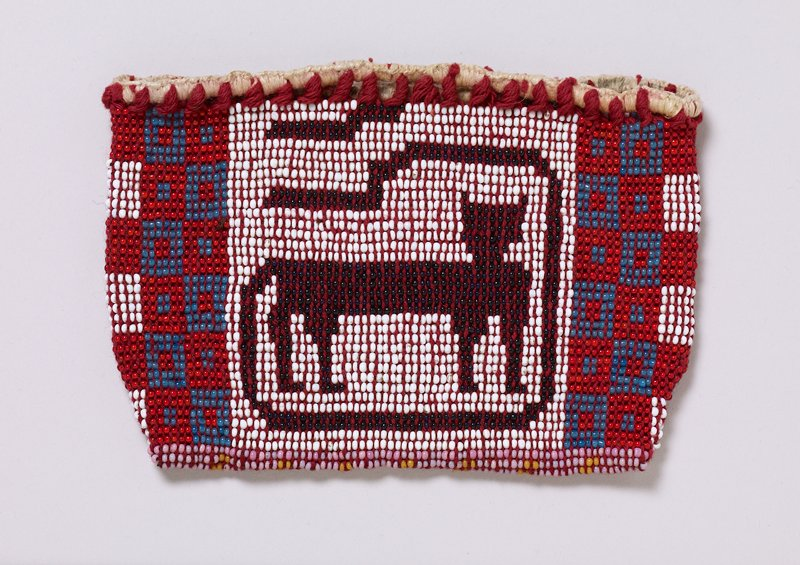 small pouch; red threads; white, red, medium blue, dark blue, pink, yellow, orange and green beads; panther on white ground with long curling tail on one side; radiating diamond designs on opposite side; white edging at top