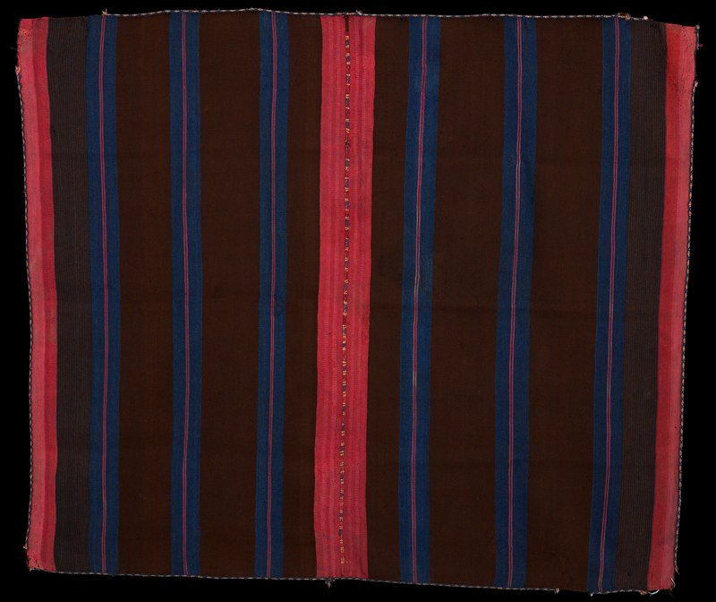 two pieces sewn together; brown stripes and blue stripes each with two pink center stripes; pink stripes at each end of panels; blue, yellow, red and white trim with diamond pattern; pink, purple and yellow central seam stitching; warp faced plain weave