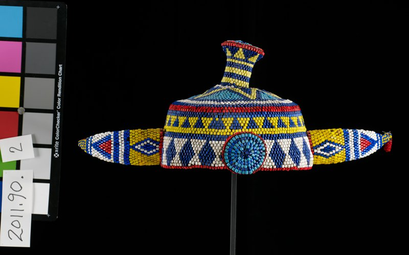 beaded crown with three bosses and two horn-like projections; red, white, blue, turquoise and yellow beads; geometric designs include triangles, diamonds and circles