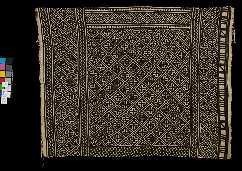 tan cloth with brown printed geometric design; eight panels joined together; designs include crosses; zigzag, triangles, lines and diamonds