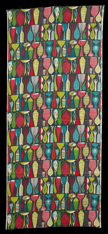 horizontal printed pattern of vases, faces and hands, goblets, mugs and trees in red, greens, aqua blue against dark blue ground