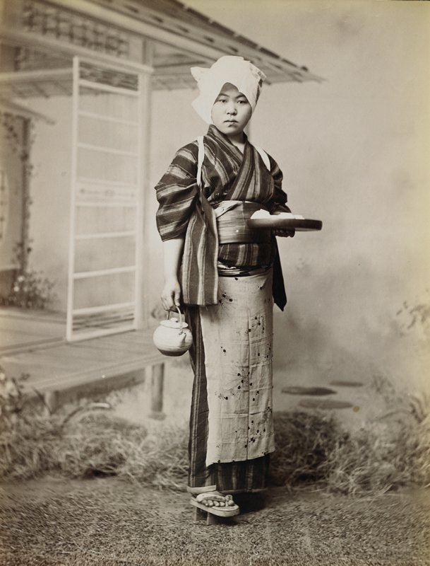 "portrait of a woman wearing a striped kimono, white cloth on her head, flowered apron, and ""geta"" sandals, holding a round tray and a teapot"