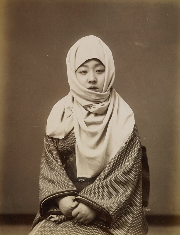 portrait of a young woman wearing a striped kimono and a white scarf wrapped around her head and neck