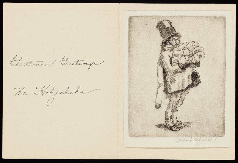 "cream-colored plain card with tipped-in print with image of a standing man wearing glasses, coat, long scarf, top hat and spats, holding many small bundles in his arms; handwritten text in black ink on left side of card: ""Christmas Greetings / The Holzschuhs"""