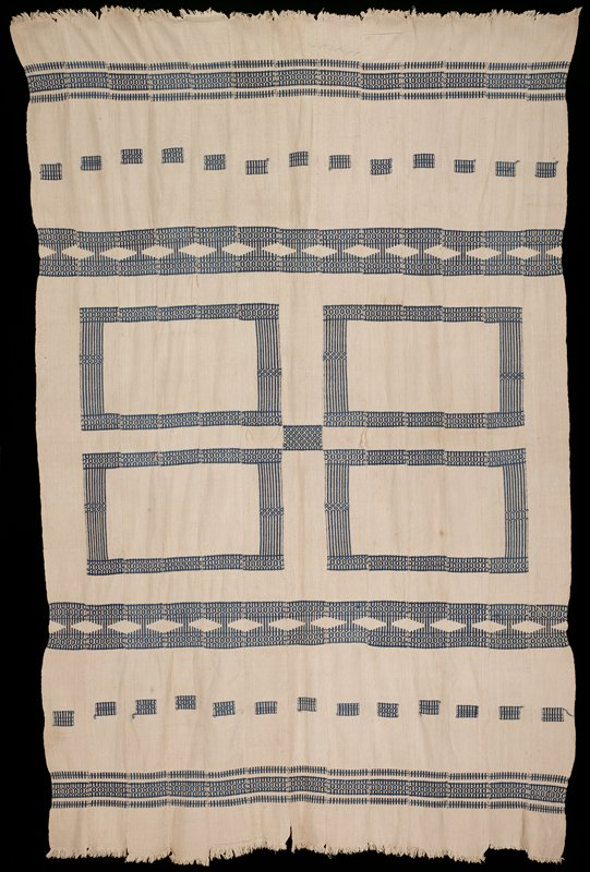 13 strips sewn together; cream-colored with blue patterns forming four large rectangles, two blue and white bands with diamonds, two patterned bands and two rows of repeating small blue patterned rectangles