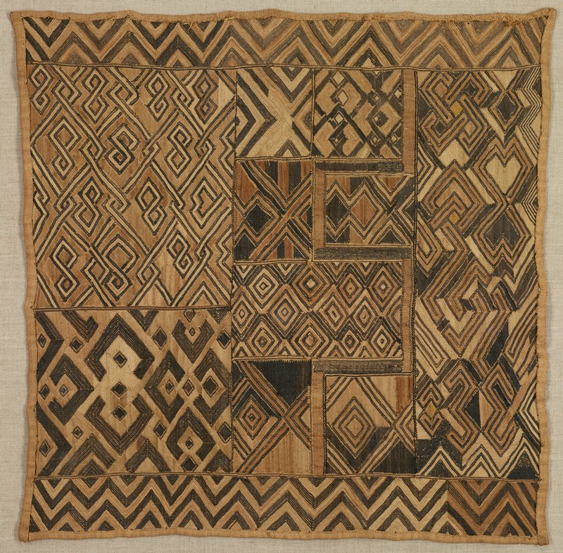 light tan ground; patchwork-like panel with sections with various geometric designs in dark, medium and light browns--primarily diamonds and zigzags; may be a pile panel with severe losses to raised pile; received mounted