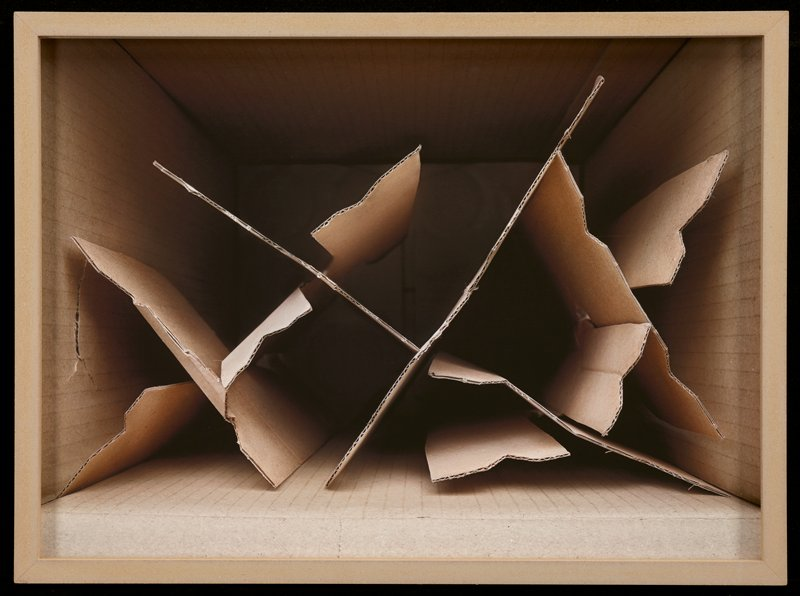 image looking into a corrugated cardboard box with cardboard pieces at interior; artist-made frame