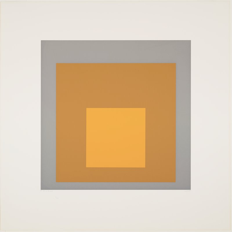 three squares on top of one another--grey, tan and orange, from outside in