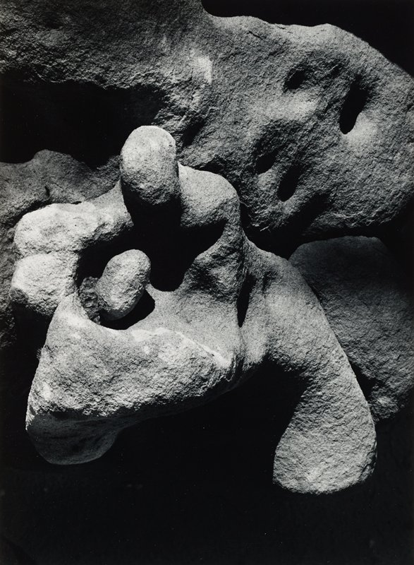 biomorphic rock formations resembling abstracted small figure embraced by larger figure