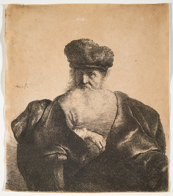 head and torso of seated old man with a long white beard wearing a cap and a large cloak; man's PR wrinkled hand resting at center of man's upper body