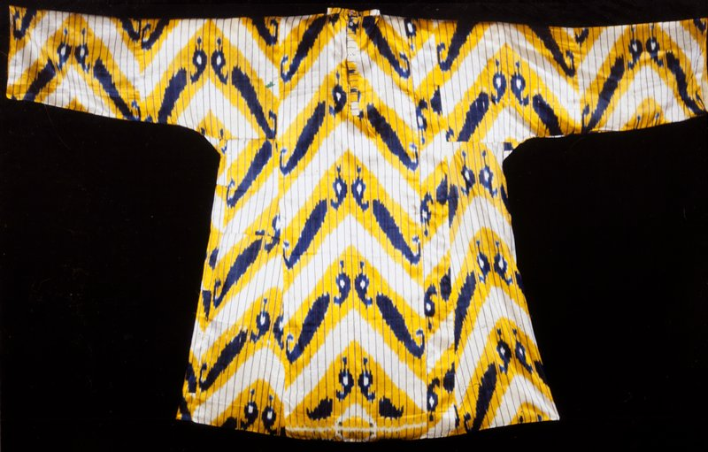Woman's blouse; white satin with bright yellow and dark blue ikat warp pattern; open both back and front.