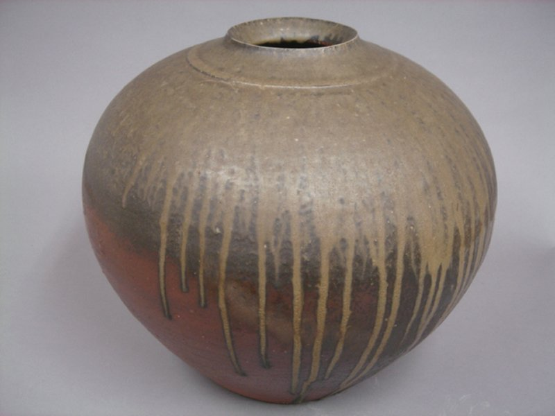 large, bulbous, narrow mouthed jar; dark olive green glaze at top, black at center, and rust colored at bottom; drips from top layers extend to bottom on one side