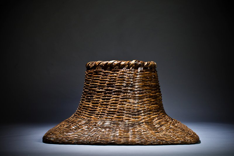 large, square base with long, round neck; wide mouth opening; closed weave; wide strips of bamboo woven around neck