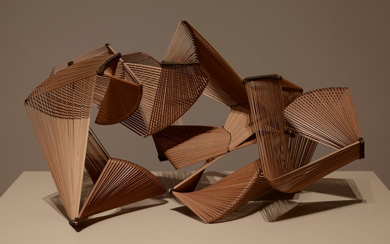 open-work abstract shape of twisting form of series of parallel bent pieces of bamboo