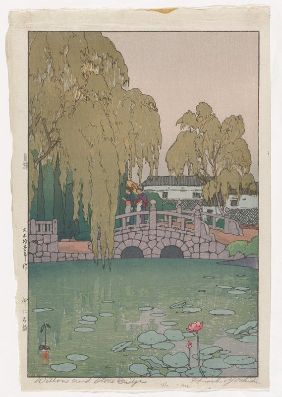 two women in kimono, one holding an umbrella cross over a double arched stone bridge; pond with blossoming lily pads in foreground; large willow tree in middle ground at L; white building with willow tree in middle ground at R