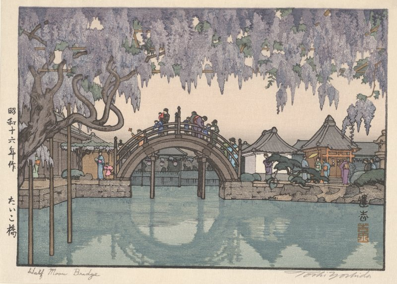 half-circle footbridge in middle ground over calm water; small buildings at left and right; many people walking; gnarled tree with purple hanging blooms across top of image