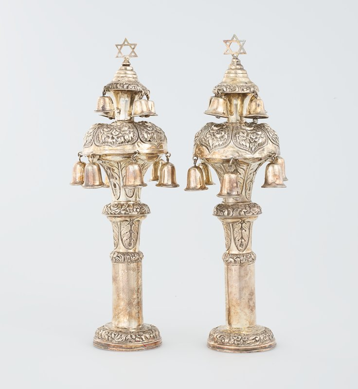 two tiered bulbous form, each tier hung with bells and topped with Star-of-David finials; decorated throughout with floral designs