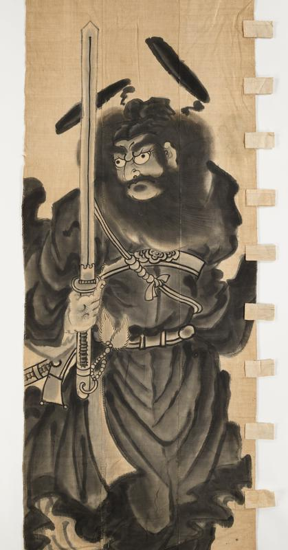 very large image of Shoki in black robes and black boots holding very tall straight sword in PR hand; very full, windblown beard and hair, fierce face, bushy eyebrows