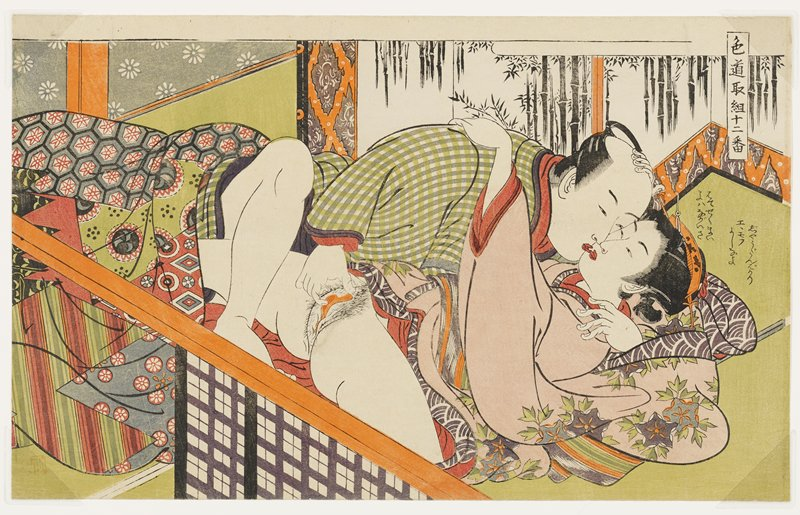 embracing couple; man touches woman's vagina; woman wears pink kimono with purple, grey, orange and white flowers; man wears a green and white kimono; screen with bamboo in URQ; text in URQ