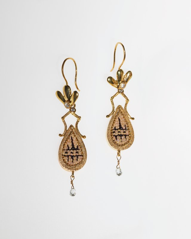 pair of French hook earrings; three-petaled flowers at top with diamond centers with teardrop-shaped pendants with tan and black geometric beadwork; tiny faceted diamond dangle drops