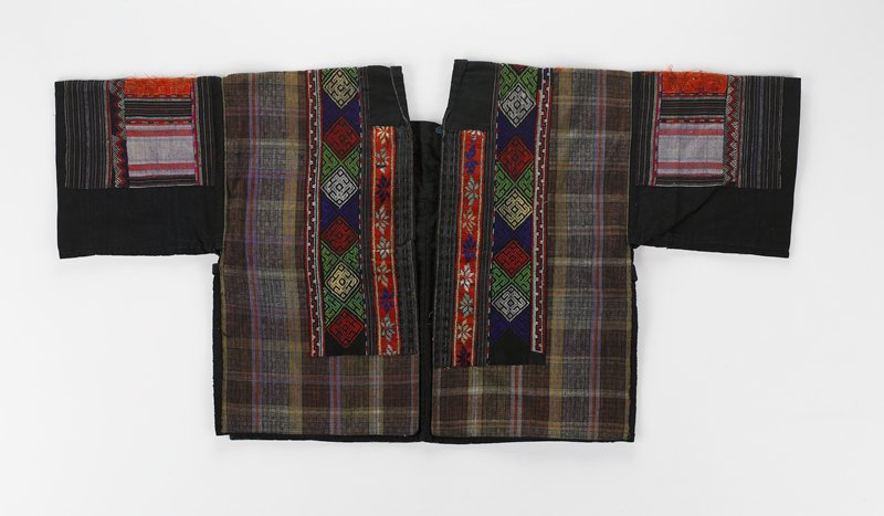 brown and green plaid over dark blue ground; vertical bands of appliqued embroidery either side of front opening and on arms; blue tie top of opening; back diamond pattern over shoulders; purple bands of decoration across bottom