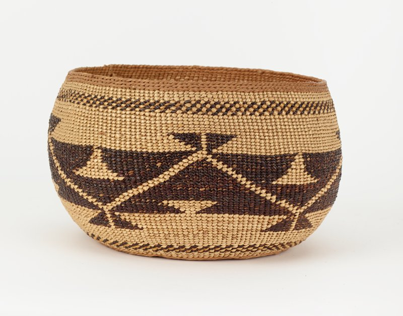 squared bottom with pointed lower corners; slightly rounded on bottom; round top rim; woven with tan, medium and dark brown tones in zigzag weaving pattern