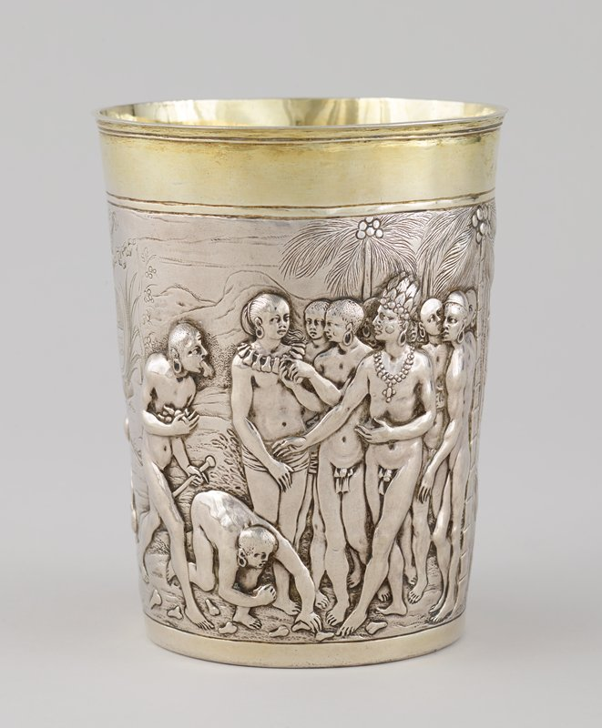 cup with sides flaring very slightly outward; flat bottom; small rim at top; gilt interior and top rim; relief scenes of Mozambique on sides; one side has battle scene with nude figures fighting with bows, staffs and clubs; at right side of scene, one group of three figures and a pair of figures appear to represent aggressors attempting to cut off their opponents' genitals; other side has nude male figure wearing feathered headdress and necklace at right extending his hand to a female figure with long hair in a ponytail wearing a loincloth, accompanied by other figures; woman appears to wear a necklace of male genitals, while two figures at left pick up and carry male genitals; incised double coat of arms surmounted by a crown and palm tree separates two scenes; long engraved inscription on underside