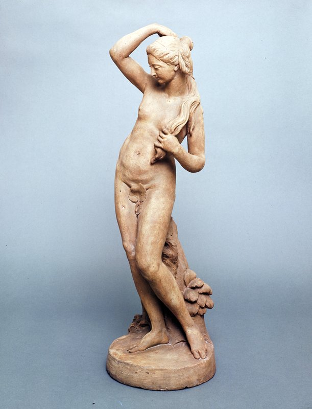 Standing nude, looking downward, her left leg extended, right arm upraised and touching head, left hand bent and holding tress of hair against her body, on circular base, with stone-colored wash.