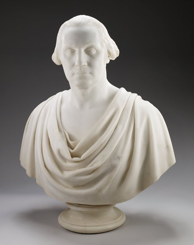 Based on the original sculpture in 1785 by Jean-Antoine-Houdon. Shoulders draped with classical toga; circular pedestal base.