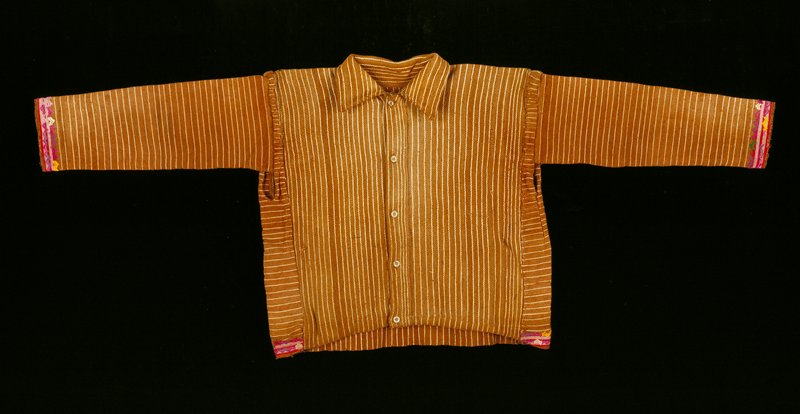 Shirt made of brown cotton, said to be ixcaco, with narrow natural white stripes; narrow bands of silk supplementary weft patterning at ends of sleeves and at hem in pink, magenta, yellow, green and white.