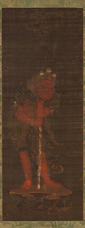 red figure with wavy, curling gold hair and a golden crown of flaming jewels; rests chin in PL hand; PL elbow propped on top of a staff he is leaning on; PR toes curled up; standing on rocky platform