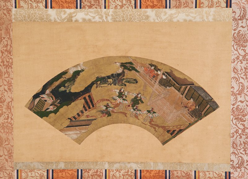 unsigned; mounted fan painting; five figures at center with striped butterfly wings; five figures seated on verandah at R watching; dragon at UL; scene is divided by gold clouds